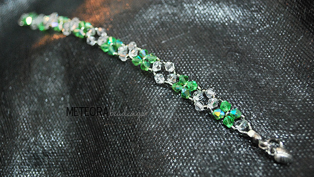 Bracelet - green and clear beads, with leaf charm