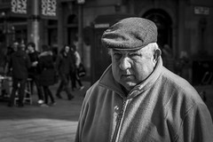 The Cap Fits (Leanne Boulton) Tags: life street city uk light shadow portrait people urban blackandwhite bw sunlight white man black detail male texture monochrome face look canon 50mm mono scotland living blackwhite eyecontact natural emotion humanity bokeh outdoor expression glasgow candid culture streetphotography streetlife scene depthoffield human cap elderly age shade portraiture 7d feeling society tone facial candidportrait candidstreetphotography candideyecontact