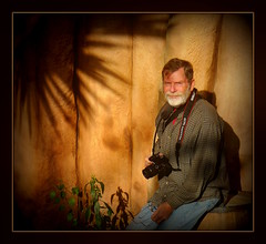 a man and his camera (milomingo) Tags: camera light shadow portrait people man male rock stone beard soft christopher mature filter frame organic softened diffusedlight thedomes over60 casualchris