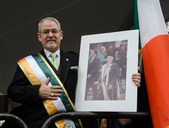 Parade President Chris Phillips with a photo of his Dad, Paul