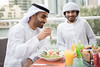 Two Handsome Arab Emirati Men Eating in a Restaurant (ImagineWhat) Tags: people white men businessman lunch outdoors salad clothing dubai adult juice islam authority style meeting meal males dining lookingdown relaxation youngadult groupofpeople cultures unitedarabemirates lunchbreak headdress lifestyles headwear handsomeman kaffiyeh youngmen healthymeal traditionalclothing leisureactivity onlymen agal weekendactivities enjoyingfood middleeasternethnicity kandura persiangulfcountries middleeasternculture ghoutra guthrah