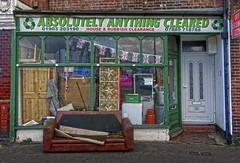 streets of worthing (maximorgana) Tags: door green sign trash worthing symbol dirty sofa