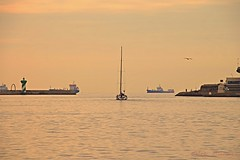 Twilight at Port Vell II (suominensde) Tags: barcelona sea sky espaa lighthouse seascape landscape faro boat mar spain nikon barco sailing waterfront outdoor pastel horizon catalonia cielo vehicle serene hazy catalua horizonte crepsculo portvell sailingboat sereno d5300