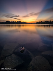 Masterpiece (t3cnica) Tags: longexposure sunset reflection nature landscapes intense singapore rocks ray glow horizon tranquility reservoir stillwater tranquil haida crepuscular elnino crepuscularray waterscapes exposureblending digitalblending watercatchment lowerpeircereservoir