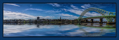 Bridge Across The Mersey (Kevin, Mr Manchester) Tags: bridge england sky panorama water architecture clouds river waterfront cheshire northwest panoramic 1855mm archways hdr waterways runcorn widnes rivermersey canon1855mm runcornbridge kevinwalker