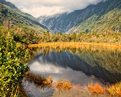 Franz Josef New Zealand (DASEye) Tags: autumn newzealand lake mountains reflection fall clouds reflections pond nikon view cloudy overcast glacier reflected vistas franzjosef stormclouds davidadamson daseye