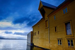 Bergen fjord (halifaxlight) Tags: blue windows sea norway architecture grey doors cloudy warehouse mustard fjord bergen woodenbuilding sandviken