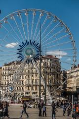 20160418 Provence, France 02430 (R H Kamen) Tags: france architecture outdoors marseille day ferriswheel buildingexterior provencealpesctedazur bouchedurhone lacanebiere incidentalpeople rhkamen