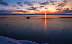 Home for the Evening (tinamar789) Tags: winter sunset sea sky snow seascape ice clouds evening boat icy seashore