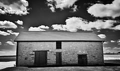 the namesake... (BillsExplorations) Tags: old sky blackandwhite monochrome stone clouds barn rural vintage illinois outdoor farm historic ruraldecay sturdy namesake stonebarn barnsandfarms franklingrove