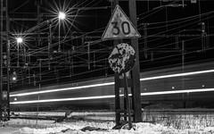 Train going by! (lindblomlinus) Tags: longexposure light blackandwhite snow monochrome sign 30 train pentax sweden outdoor trains number numbers trainstation lighttrails sverige bnw jrn longexpo samyang