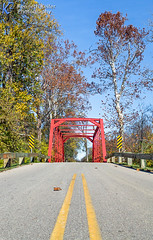 Red Iron Bridge (Kenneth Keifer) Tags: old bridge autumn trees red color fall nature leaves metal rural vintage landscape october highway midwest colorful iron crossing scenic indiana historic foliage sycamore transportation span roadway lowangle yellowline atterbury johnsoncounty campatterbury massillonbridgecompany stonearchroad atterburyfishandwildlifearea ninevehcreek