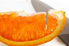 A fresh slice (_Matt_T_) Tags: orange fruit juicy pentax knife highkey tabletop af360fgz af540fgz smcpa100mmf40macro k5iis singlechallenges pttlwireless