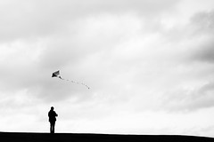 Kite flying (V Photography and Art) Tags: white black silhouette clouds contrast kent wind hill minimal bigsky