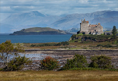 Duart Castle and Ben Nevis (kate willmer) Tags: sea mountains building castle water architecture landscape island scotland bennevis inlet bushes mull channel mclean duartcastle uklandscape