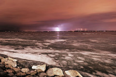 First Storm of the Year (Kirby Wright) Tags: county light orange lake storm uw wisconsin point frozen nikon memorial rocks long exposure picnic university angle union wide line madison shore pollution dane lightning mendota ultra f28 thunder d3 manfrotto universityofwisconsinmadison 14mm rokinon madison365