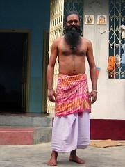 Time for Yoga (Isabel Sommerfeld) Tags: world travel people india man color men yoga colorful asia traditions towel yogi meditation traveling tradition spiritual hindu bengal indien resa individual bengali baul mnniska resande santiniketan westernbengal