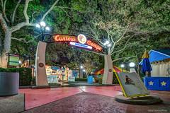 Going to Town (orlandobrothas) Tags: trees vacation playground night lights monkey book george kid orlando nikon florida animation universal curious studios tamron hdr zone 2016 d5300