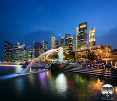 Fullerton Hotel | Remembering Lee Kuan Yew (kenneth chin) Tags: city yahoo google twilight nikon singapore asia projector bluehour nikkor merlion verticalpanorama fullertonhotel marinabay uob maybank leekuanyew digitalblending d810 thesail singaporebusinessdistrict 1424f28g