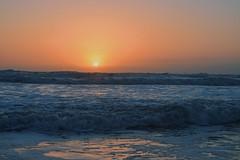 (delaneyspicer) Tags: ocean morning light sunset sky orange sun beach water yellow clouds rainbow pretty waves shadows florida hues shore ripples lovely splash daytona cocoa simple breathtaking