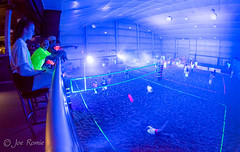 Black-light indoor beach volleyball - wide view (rikki480) Tags: blue light black college beach sports club sand uv indiana indoor tournament blacklight flourescent volleyball empowered fortwayne pcc