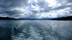 Wake (halifaxlight) Tags: blue sky lake water clouds reflections landscape costarica wake hills arenal lakearenal