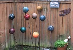 Bowling Balls (matthetube) Tags: seattle art yard fence ball folk south bowling