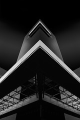 The Triangles (Minas Stratigos) Tags: light sky bw white black architecture dark minas geometry space sony shapes vision buidling shaping a6000