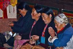 India-Arunachal Pradesh-pilgrims at Tawang monastery (venturidonatella) Tags: people india colors portraits persona women asia buddha buddhism monastery d200 colori ritratti gentes monastero pilgrims tawang pellegrini arunachalpradesh nikond200
