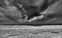 Ice, Water, Clouds (mswan777) Tags: sky bw white lake snow seascape black ice beach nature water monochrome clouds outdoors nikon michigan great shoreline lakes scenic sigma shore 1020mm ansel d5100