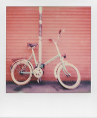 To go somewhere - TWO (ale2000) Tags: red urban bike bicycle wall polaroid blurry parking blurred pole 600 parked somewhere ontheroad slr680 impossible sfocato urbanscenery nemalogue