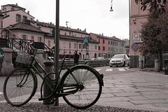 something wrong (La Baroque) Tags: milan green church bike monocromo san milano calm clear chiesa piazza chiara sella navigli cristoforo allaperto monocromatico saturazione sellino bicibletta