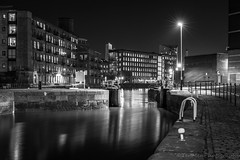 River Aire by night (jasonmgabriel) Tags: city bw white black building monochrome night river dock streetlight lock leeds aire towpath