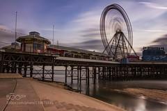 Ferris Wheel (AleshaOleg) Tags: city uk travel blue sunset sea summer england sky sun beach water wheel night clouds seaside long exposure ferris lancashire blackpool