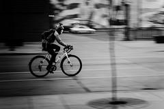 street-darkness-to-light2 (jeff-tidwell) Tags: street city light blackandwhite bw motion blur monochrome bike bicycle dark streetphotography