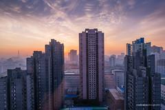 Sunrise in Pyongyang City (reubenteo) Tags: sunset building sunrise landscape asia korea communist communism kimjongil socialist socialism northkorea pyongyang kimilsung kimjongun