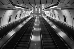 Escalators (pavel.suva) Tags: city urban blackandwhite monochrome subway prague metro empty escalator praga symmetry infrastructure escalators fragment mustek