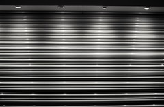 Illuminator - 56 (L D Middleton) Tags: blackandwhite bw monochrome shop contrast four lights fuji shutter roller fujifilm illuminator audenshaw tclx100 x100t ldmiddleton