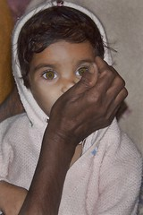 the eyes have it (Pejasar) Tags: portrait india girl rural eyes child young held punjab grandmothersarm
