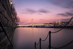 Vanishing Tide (Otto Berkeley) Tags: uk longexposure bridge pink blue sunset england london water thames river boats lights chains chelsea crossing suspension britain dusk tide smooth victorian granite lamps railing battersea embankment albertbridge