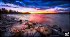 Rocky Lake Sunset (Moe Ali Photography) Tags: longexposure blue sunset sky panorama orange lake reflection calgary clouds canon lens relax landscape rocks outdoor mark wide smooth calming ii alberta 7d stunning dreamy ripples 10mm glenmore moeali canon1018mmstm
