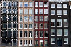 Sisters (RosLol) Tags: windows netherlands amsterdam architecture facade buildings pattern acqua architettura olanda finestre damrak roslol