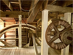 Wheels of Time (Mary Faith.) Tags: building mill water metal timber spin wheels historic nz inside flour cogs beams mechanics wanganui pullies