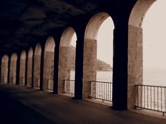 Gallerie (fotofonino) Tags: street blackandwhite italy monochrome architecture strada italia tunnel olympus scilla calabria biancoenero archi gallerie monocromatico strutture