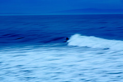 Cold zoom (El Cajon) Tags: ocean california santacruz blur speed us surf unitedstates surfer wave