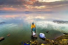 Washer-man .. (Ragavendran / Rags) Tags: sky lake colours dramatic clothes hues colourful drama chennai washing washer tamilnadu cwc chengalpattu washerman chengalpet chennaiweekendclickers ragavendran kolavailake