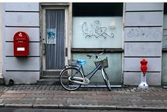 Street Bike (threejumps) Tags: door red bicycle wall copenhagen denmark graffiti post decay scrawl scandinavia