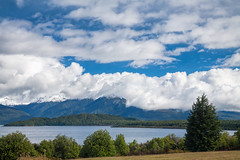 Lake Manapouri in New Zealand (Dmitri Naumov) Tags: newzealand summer lake nature water weather landscape outdoors photography pond cloudy nobody nopeople shore lakeshore remote manapouri ambience 2010 fiordland mountainrange traveldestinations colorimage beautyinnature southislandnewzealand