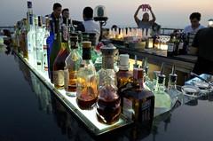 Rooftop bar, Bangkok (jeremyhughes) Tags: city sunset sky urban rooftop bar thailand evening bottles bangkok wideangle alcohol grdigital ricoh ricohgr nightfall grd rooftopbar