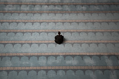 Praying Man (Igor Voller) Tags: blue man black lines carpet alone russia moscow muslim islam prayer religion pray praying mosque parallel